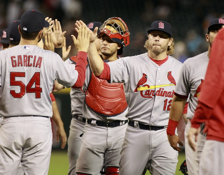 St. Louis Cardinals congratulate each other on a victory