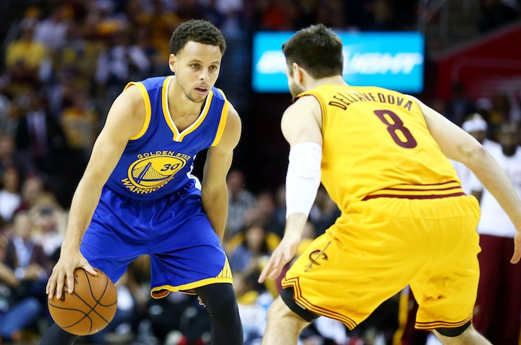 Stephen Curry prepares to drive against Matthew Dellavedova