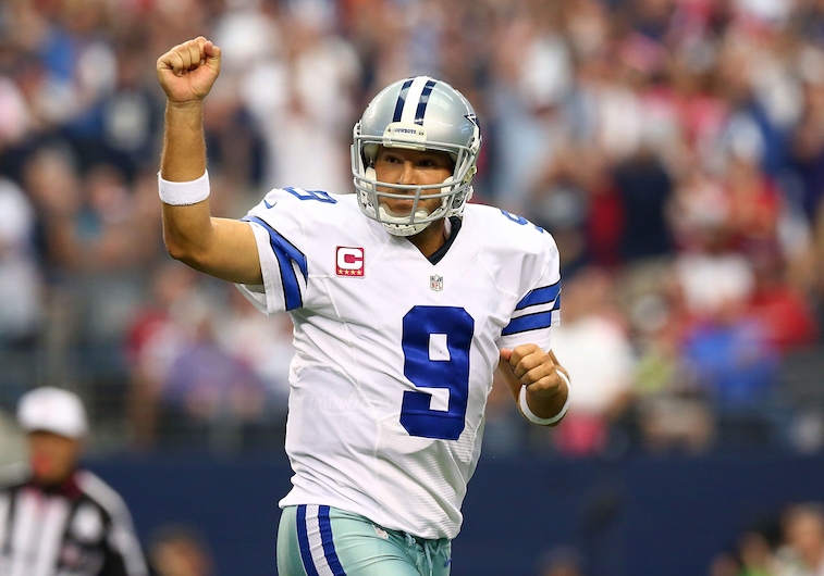Tony Romo celebrates a touchdown pass