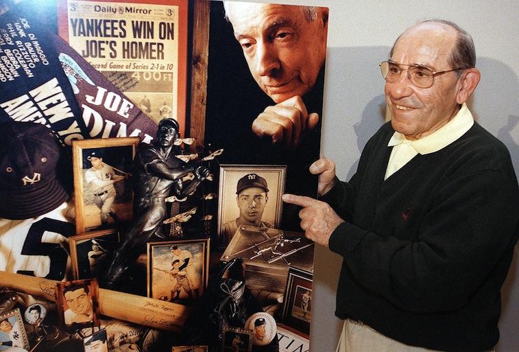 Yogi Berra points to a collage of Joe DiMaggio