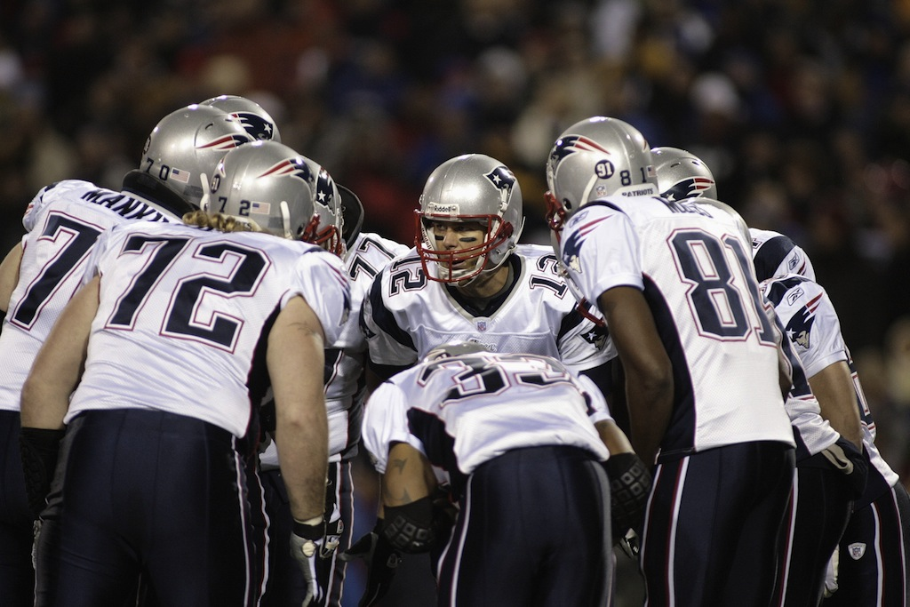 The New England Patriots in the huddle