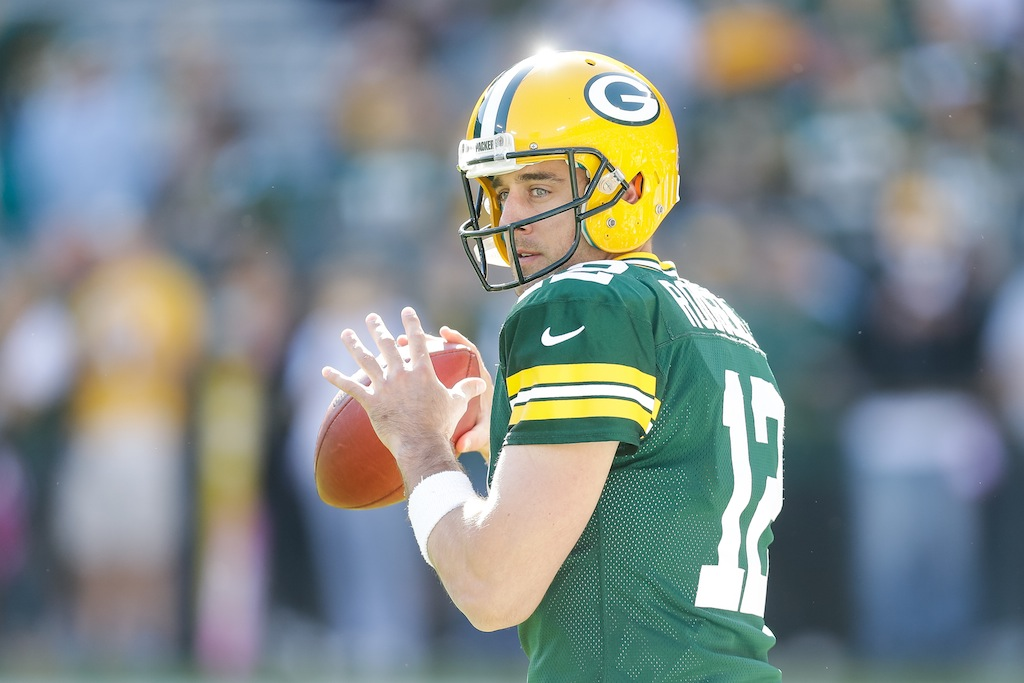 Aaron Rodgers warms up