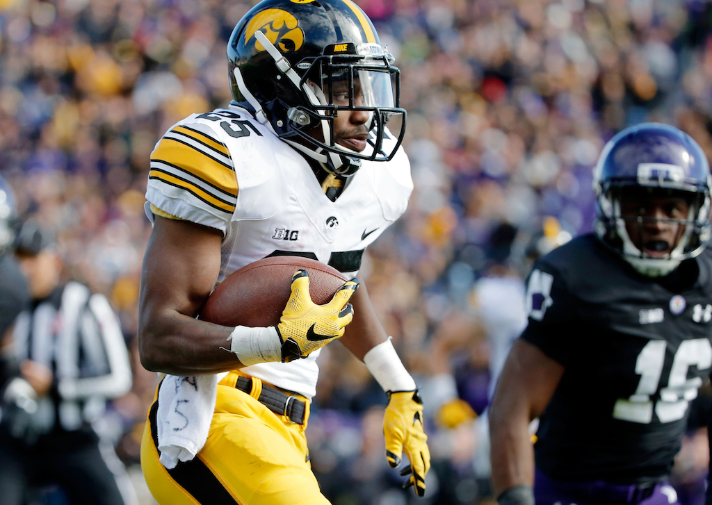 EVANSTON, IL - OCTOBER 17: Akrum Wadley #25 of the Iowa Hawkeyes rushes against the Northwestern Wildcats during the second quarter at Ryan Field on October 17, 2015 in Evanston, Illinois. (Photo by Jon Durr/Getty Images)