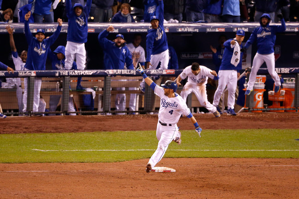 Alex Gordon celebrates a huge home run in the World Series.