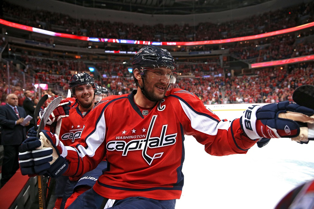 WASHINGTON, DC - OCTOBER 10: Alex Ovechkin #8 of the Washington Capitals celebrates a teammates goal against the New Jersey Devils at Verizon Center on October 10, 2015 in Washington, DC. The Washington Capitals won, 5-3.