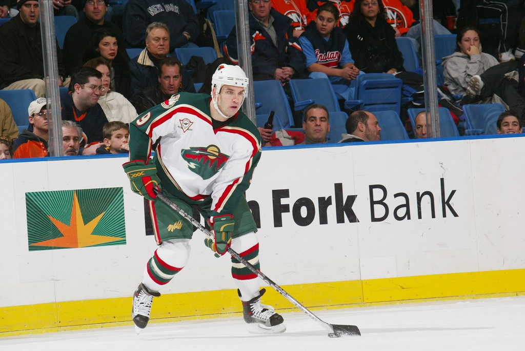 UNIONDALE, NY - DECEMBER 13:  Right wing Alexandre Daigle #9 of the Minnesota Wild handles the puck against the New York Islanders at the Nassau Coliseum on December 13, 2005 in Uniondale, New York. The Wild defeated the Islanders 4-3.