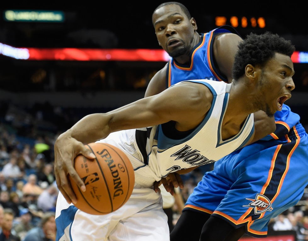 Andrew Wiggins drives past Kevin Durant