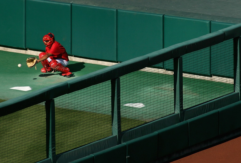 ANAHEIM, CA - AUGUST 12: Bullpen catcher Steve Soliz #61 of the Los Angeles Angels of Anaheim warms up pitchers before a game against the Seattle Mariners at Angel Stadium on August 12, 2008 in Anaheim, California.