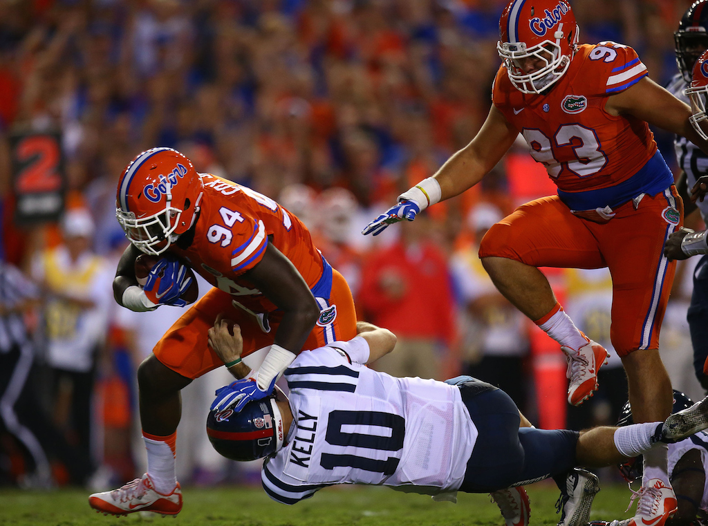 Bryan Cox #94 of the Florida Gators picks up a ball fumbled by Chad Kelly #10 of the Mississippi Rebels