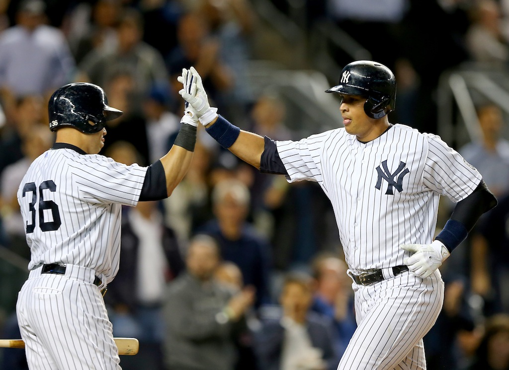Carlos Beltran (L) and Alex Rodriguez high five