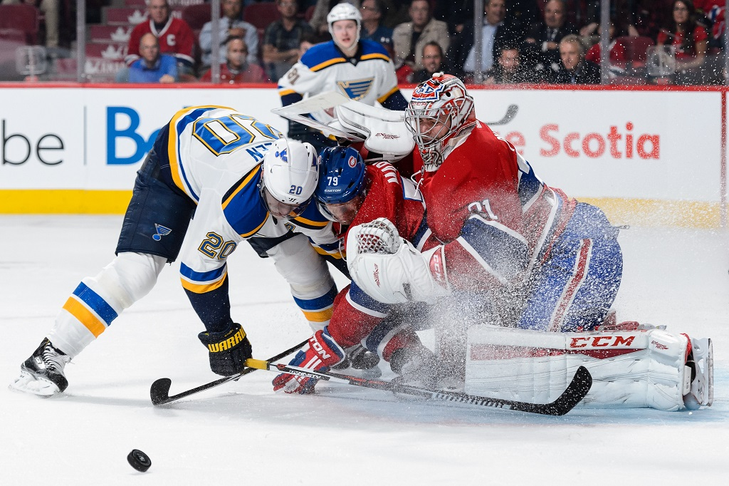 MONTREAL, QC - OCTOBER 20:  Alexander Steen #20 of the St. Louis Blues and Andrei Markov #79 of the Montreal Canadiens crash into goaltender Carey Price #31 during the NHL game at the Bell Centre on October 20, 2015 in Montreal, Quebec, Canada.