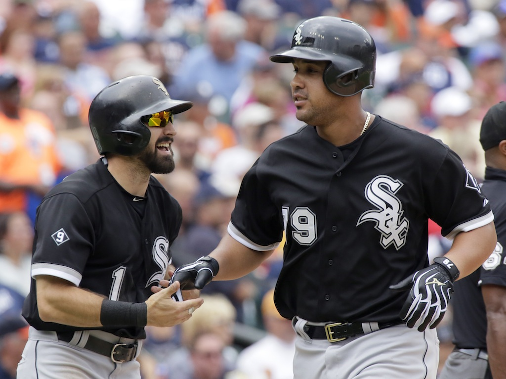 Adam Eaton #1 of the Chicago White Sox celebrates with Jose Abreu #79 of the Chicago White Sox after the pair scored against the Detroit Tigers