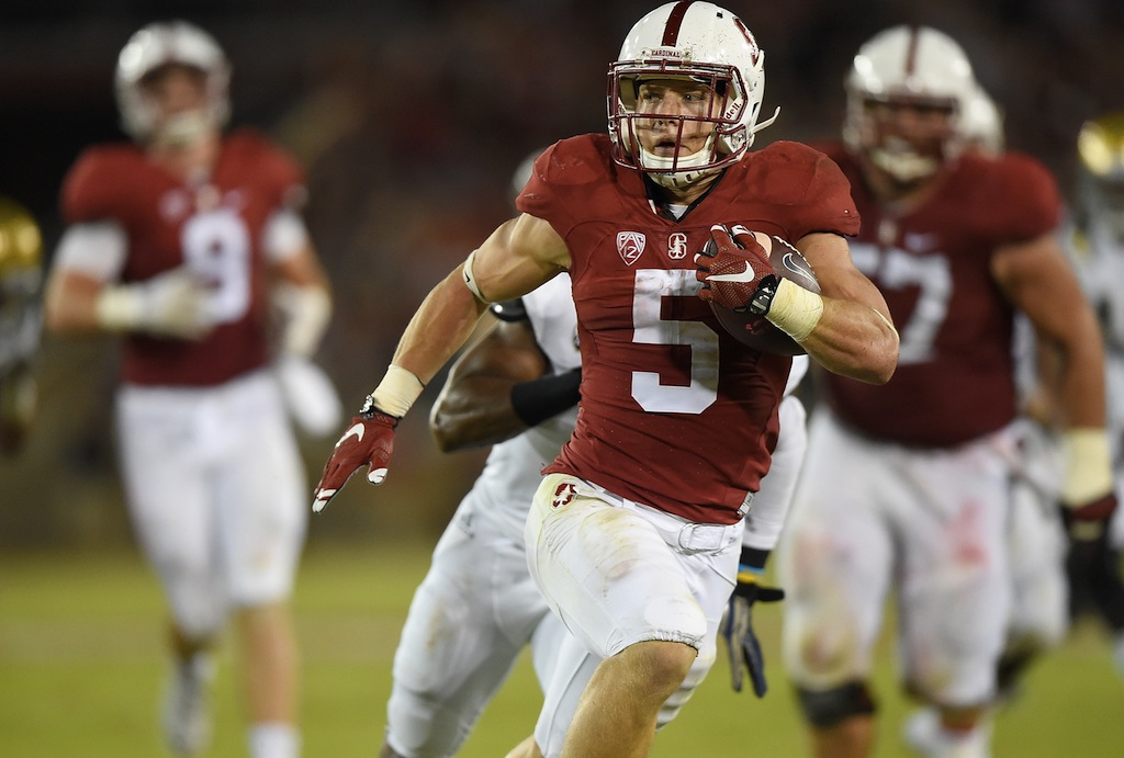 Christian McCaffrey, now with Carolina, makes a run for it.
