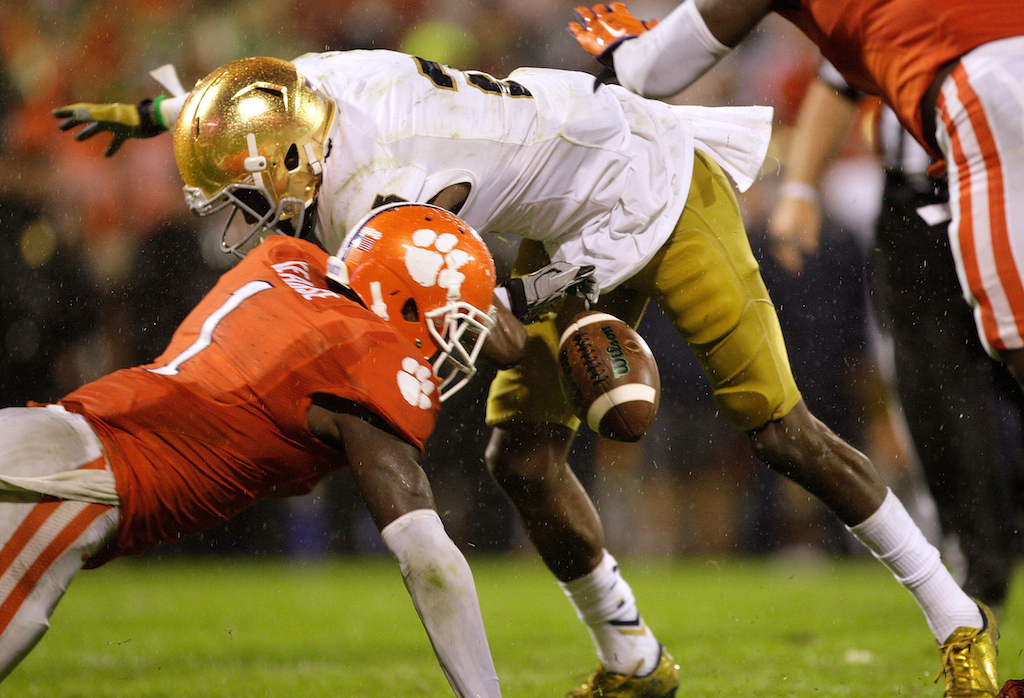 Jayron Kearse #1 of the Clemson Tigers forces a fumble against C.J. Prosise #20 of the Notre Dame Fighting Irish