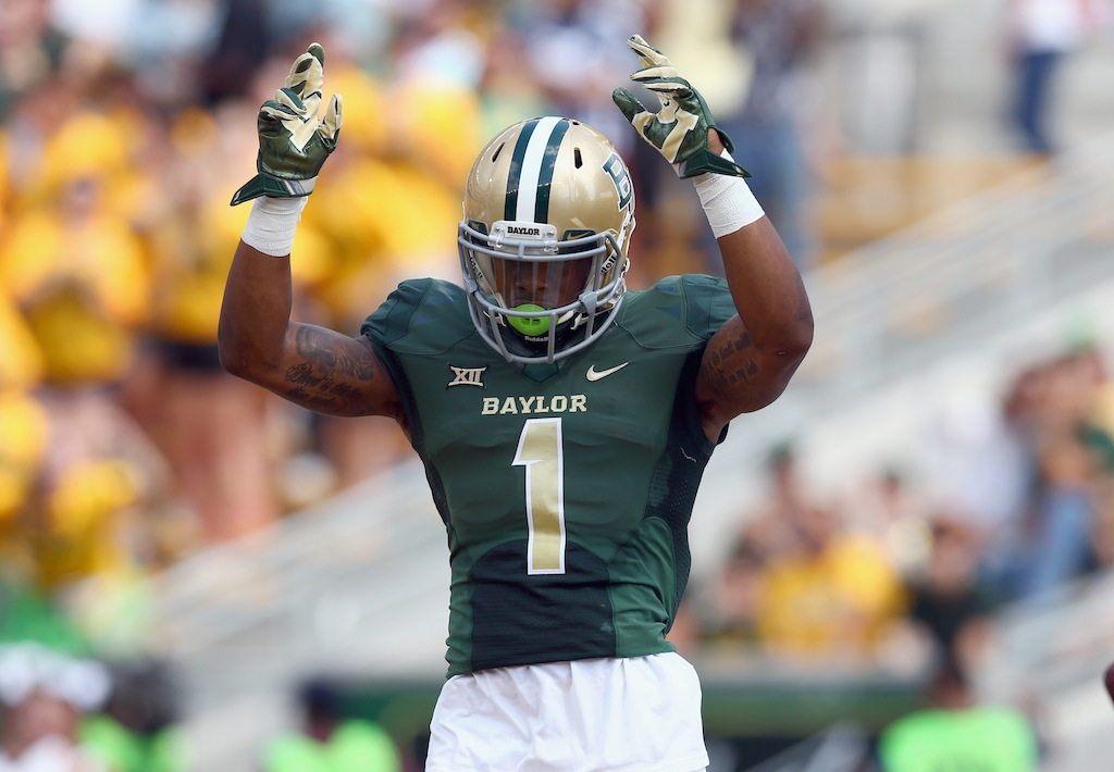 Corey Coleman celebrates after scoring a touchdown