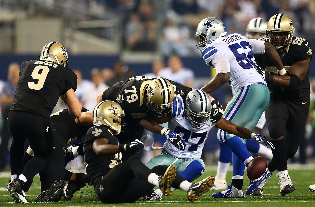 ARLINGTON, TX - SEPTEMBER 28:  J.J. Wilcox #27 of the Dallas Cowboys recovers a fumble against the New Orleans Saints in the second half at AT&T Stadium on September 28, 2014 in Arlington, Texas.