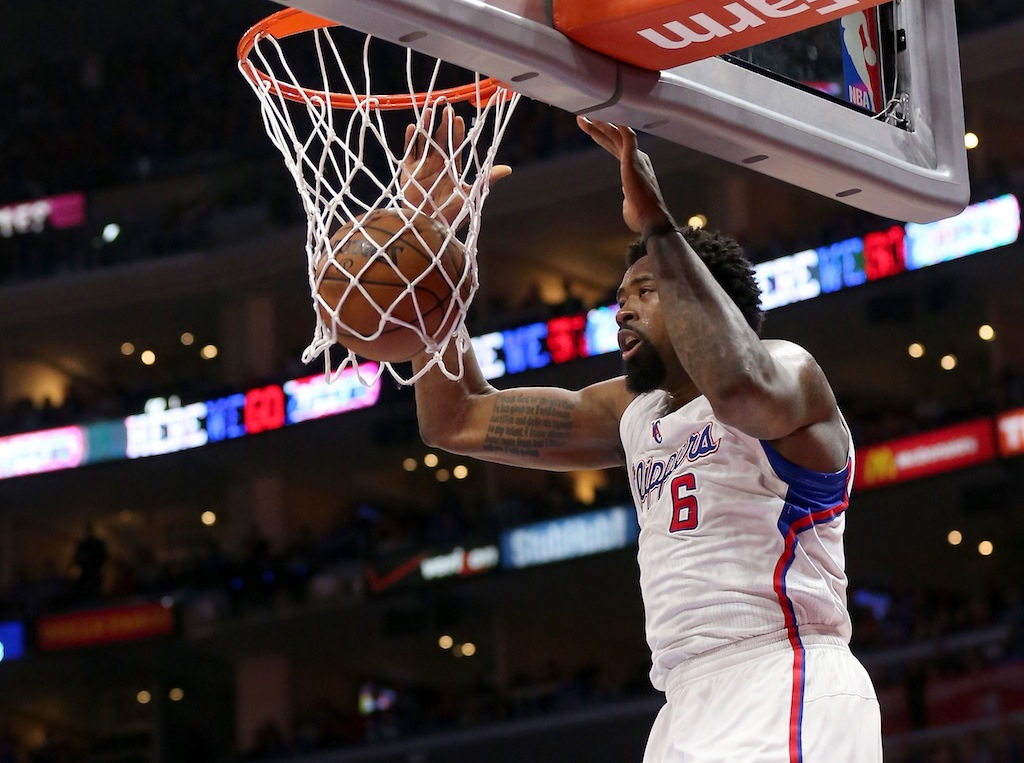 DeAndre Jordan dunks the ball.