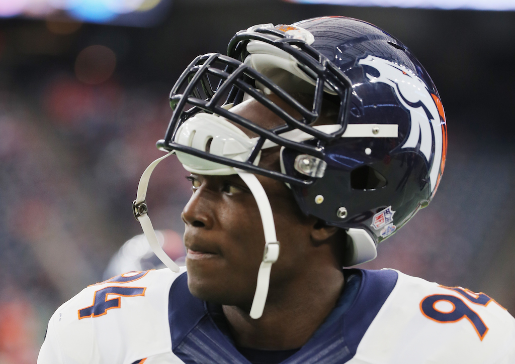 DeMarcus Ware looks on before the game