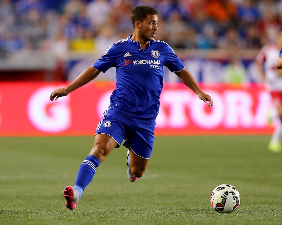 Eden Hazard dribbles the ball for Chelsea