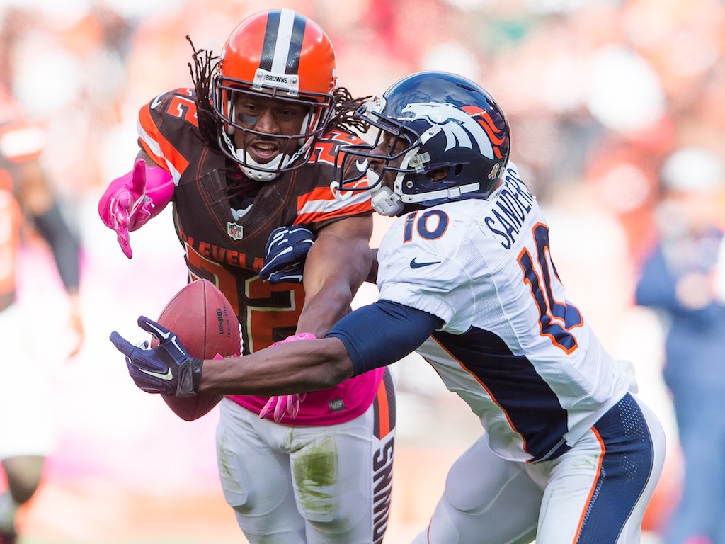 Cornerback Tramon Williams #22 of the Cleveland Browns breaks up a pass intended for wide receiver Emmanuel Sanders #10 of the Denver Broncos