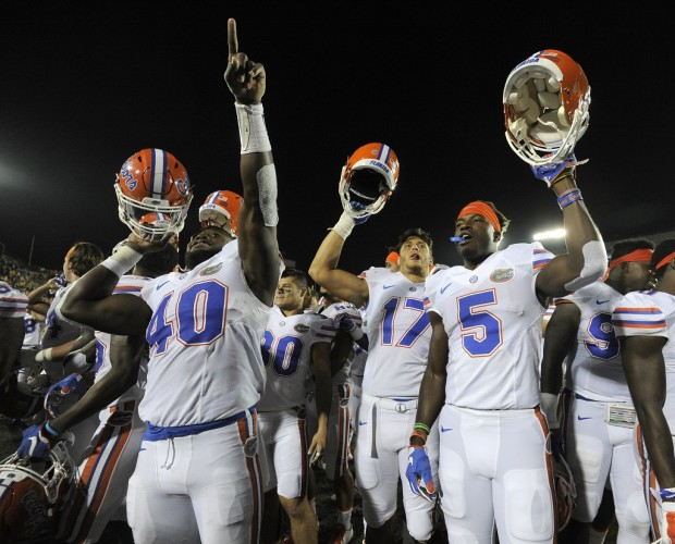 COLUMBIA , MO - OCTOBER 10:  Members of the Florida Gators celebrate a 21-3 win over the Missouri Tigers at Memorial Stadium on October 10, 2015 in Columbia, Missouri.  (Photo by Ed Zurga/Getty Images)