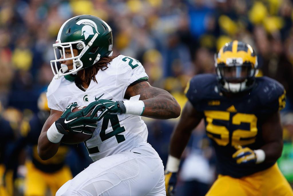 MSU's Gerald Holmes runs against Michigan