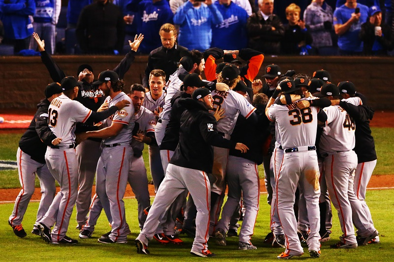 The San Francisco Giants celebrate after defeating the Kansas City Royals to win Game Seven of the 2014 World Series