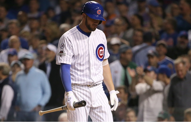Kris Bryant strikes out and heads back to the dugout.