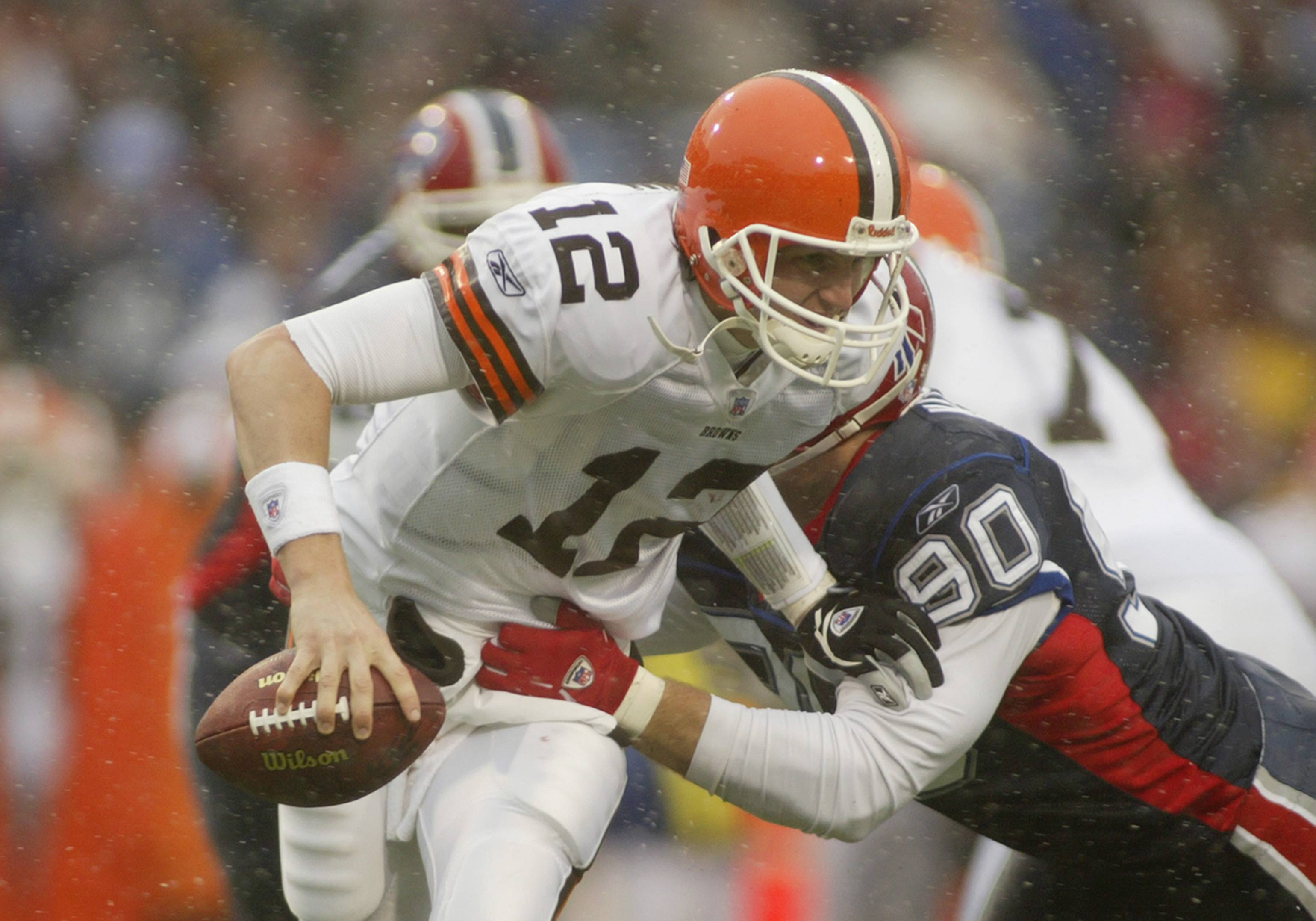 Quarterback Luke McCown of the Cleveland Browns is sacked by defensive end Chris Kelsay.