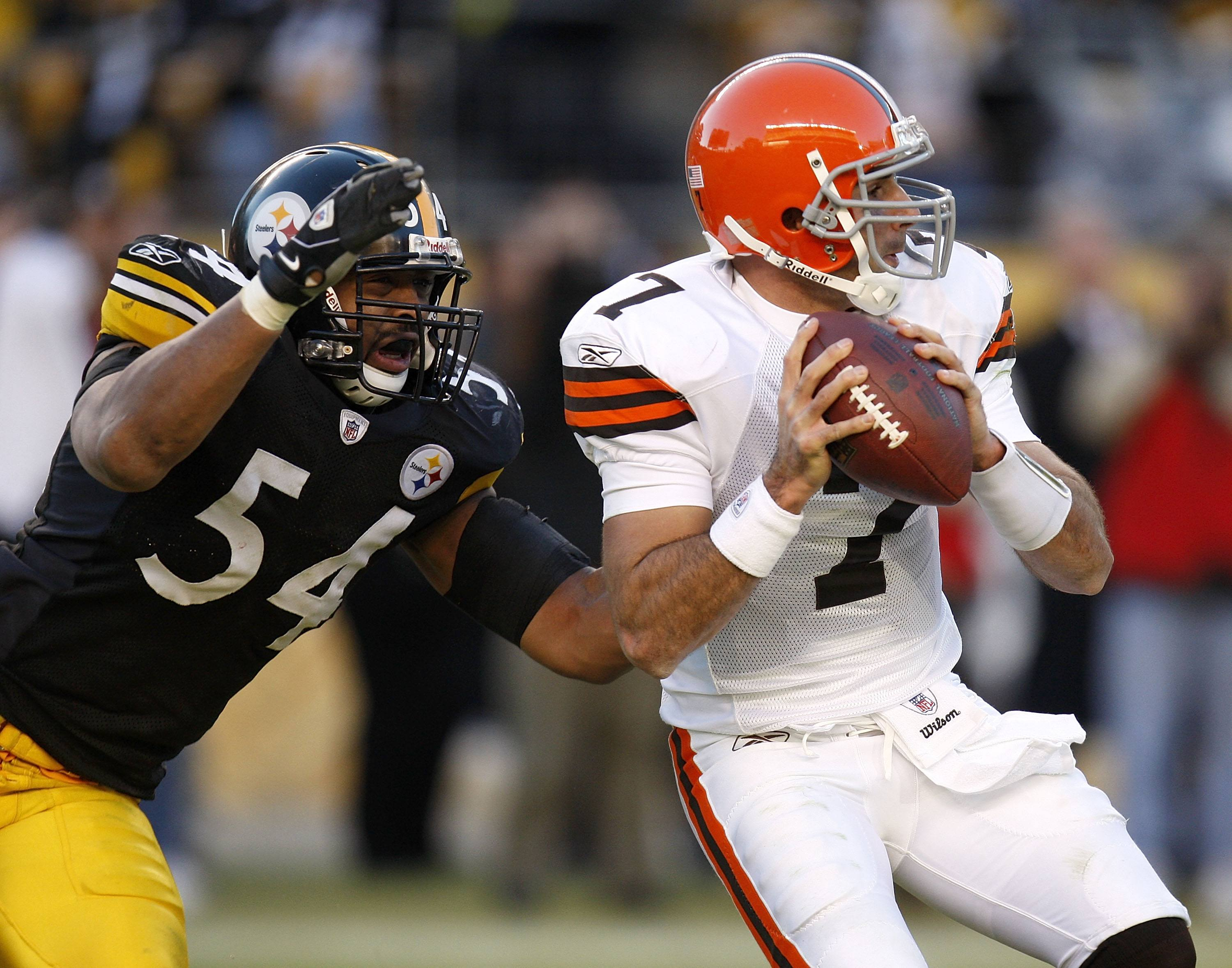 Bruce Gradkowski of the Cleveland Browns gets sacked by Andre Frazier of the Pittsburgh Steelers.