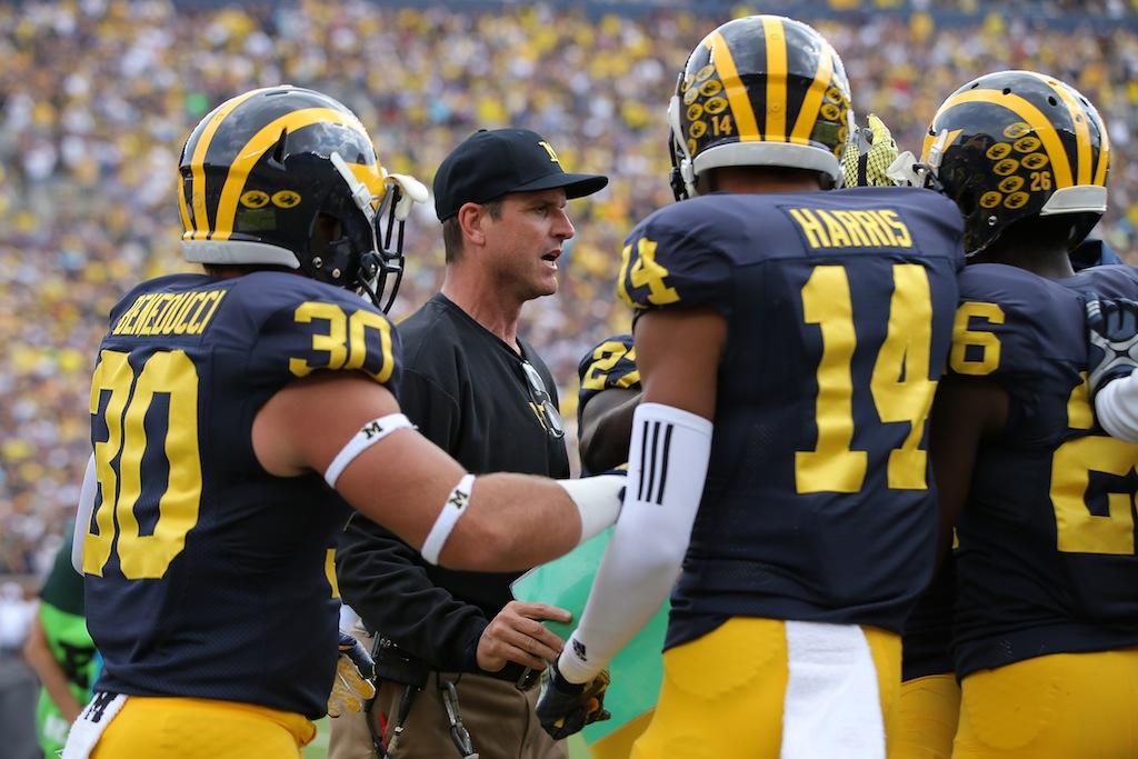 Jim Harbaugh talks to the Michigan players
