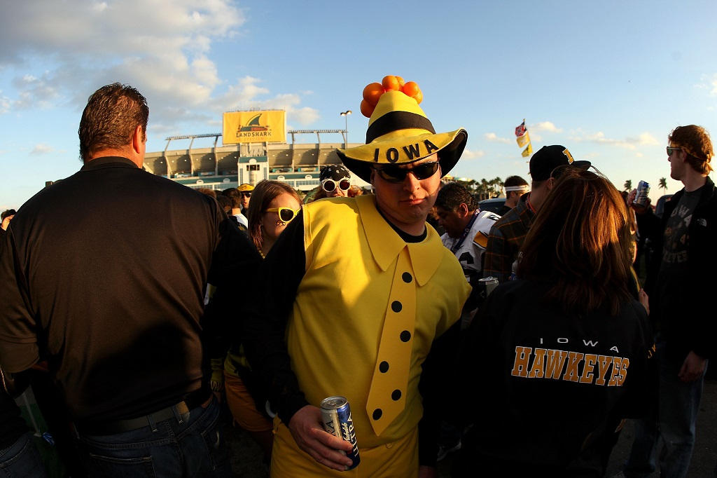 MIAMI GARDENS, FL - JANUARY 05:  A fan of the Iowa Hawkeyes tailgates in the parking lot prior to Iowa playing against the Georgia Tech Yellow Jackets during the FedEx Orange Bowl at Land Shark Stadium on January 5, 2010 in Miami Gardens, Florida.  (Photo by Streeter Lecka/Getty Images)