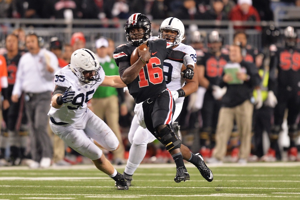 J.T. Barrett #16 runs against Penn State
