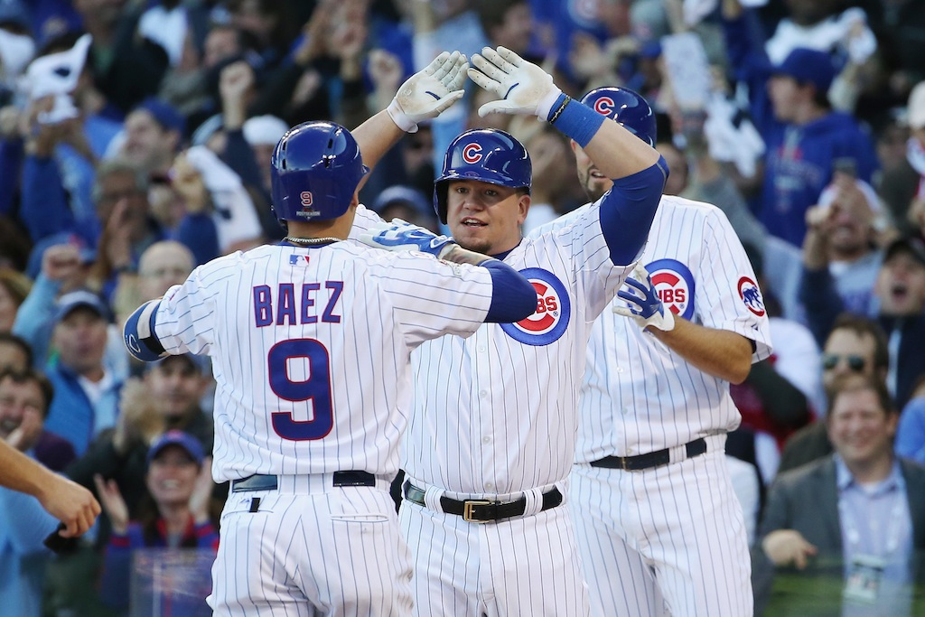 Javier Baez is congratulated after hitting a home run in the NLDS