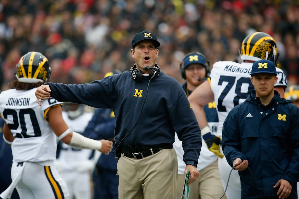 Jim Harbaugh reacts during a game against Maryland