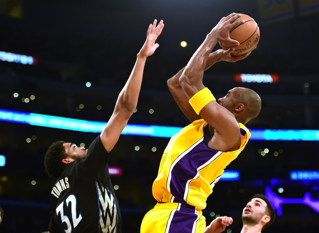 Kobe Bryant shoots against the Timberwolves