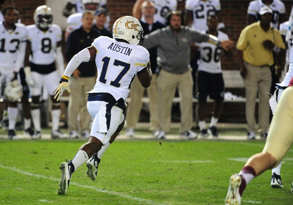Lance Austin returns a blocked FG for a touchdown