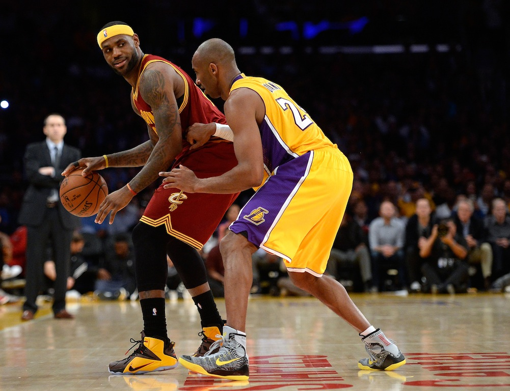 LeBron James is guarded by Kobe Bryant