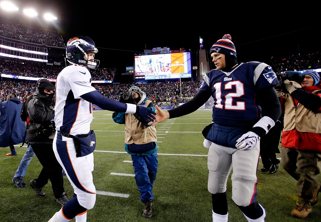 FOXBORO, MA - NOVEMBER 24: Quarterback Peyton Manning #18 of the Denver Broncos and quarterback Tom Brady #12 of the New England Patriots shake hands after the New England Patriots defeated the Denver Broncos 34-31 in overtime at Gillette Stadium on November 24, 2013 in Foxboro, Massachusetts.