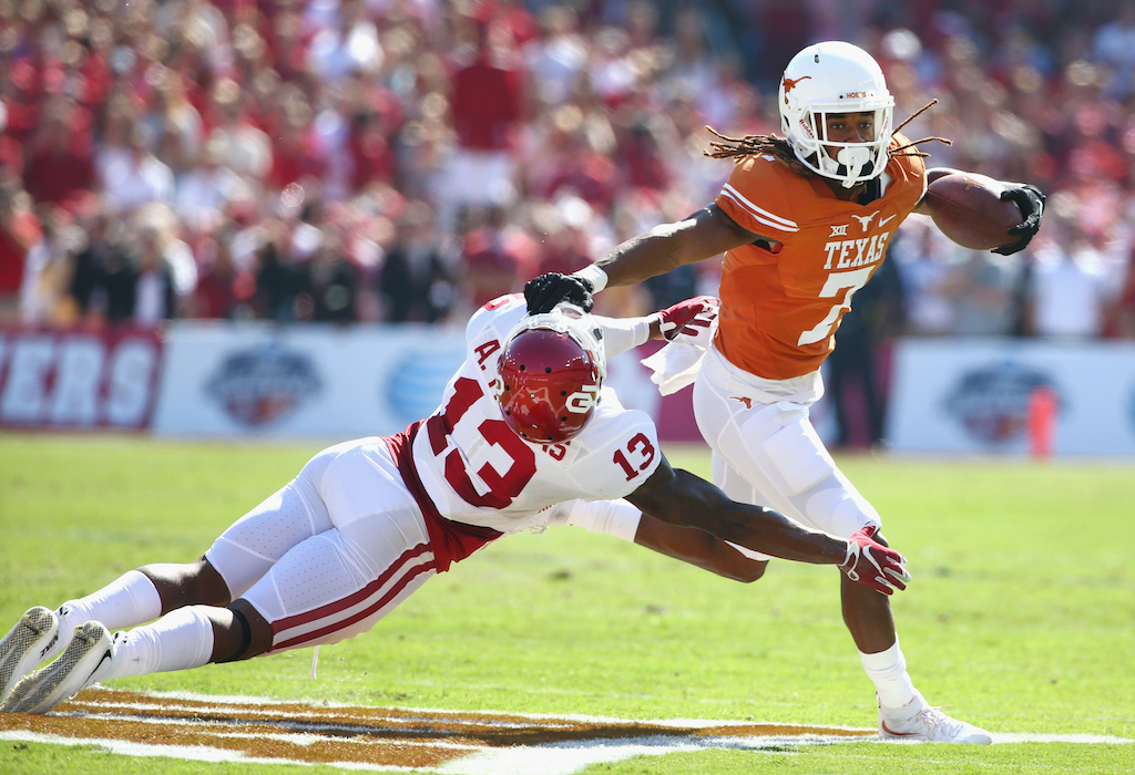 Tom Pennington/Getty Images Marcus Johnson #7 of the Texas Longhorns scores a touchdown against Ahmad Thomas #13 of the Oklahoma Sooners
