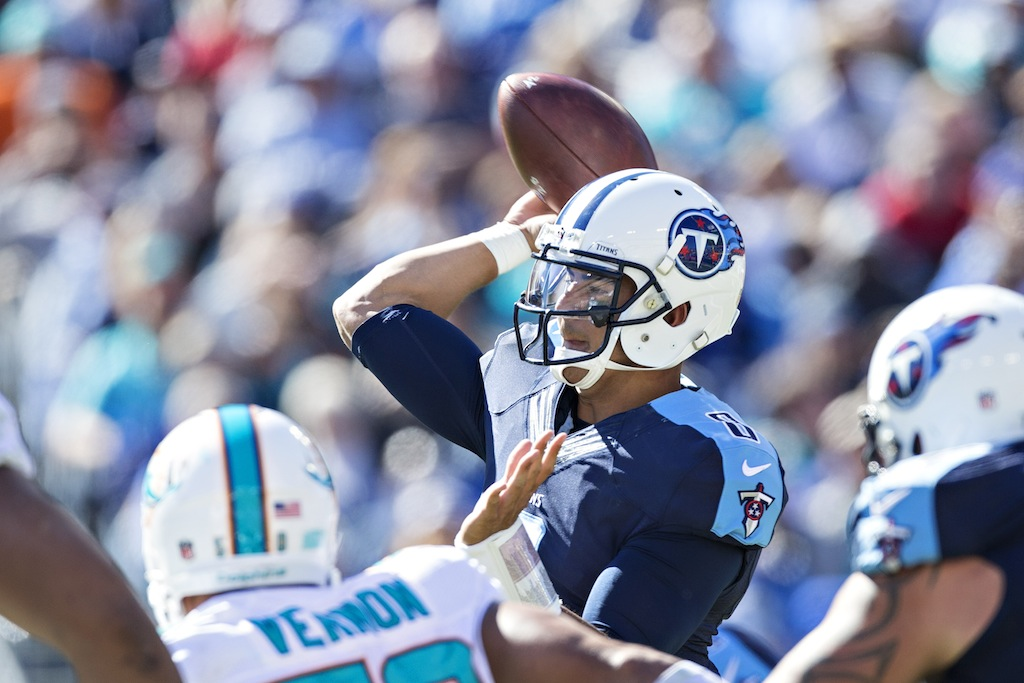 NASHVILLE, TN - OCTOBER 18: Marcus Mariota #8 of the Tennessee Titans throws a pass under pressure during a game against the Miami Dolphins at LP Field on October 18, 2015 in Nashville, Tennessee. The Dolphins defeated the Titans 38-10. (Photo by Wesley Hitt/Getty Images)