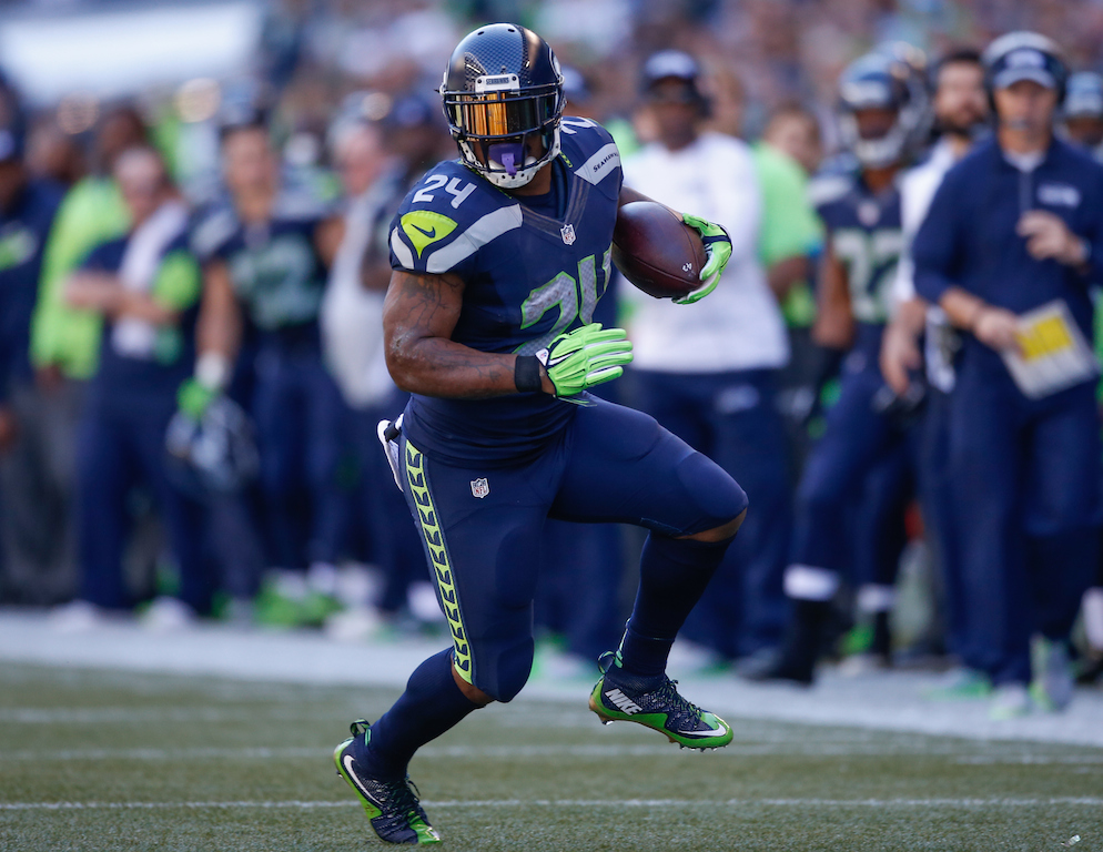 Marshawn Lynch runs against the Bears