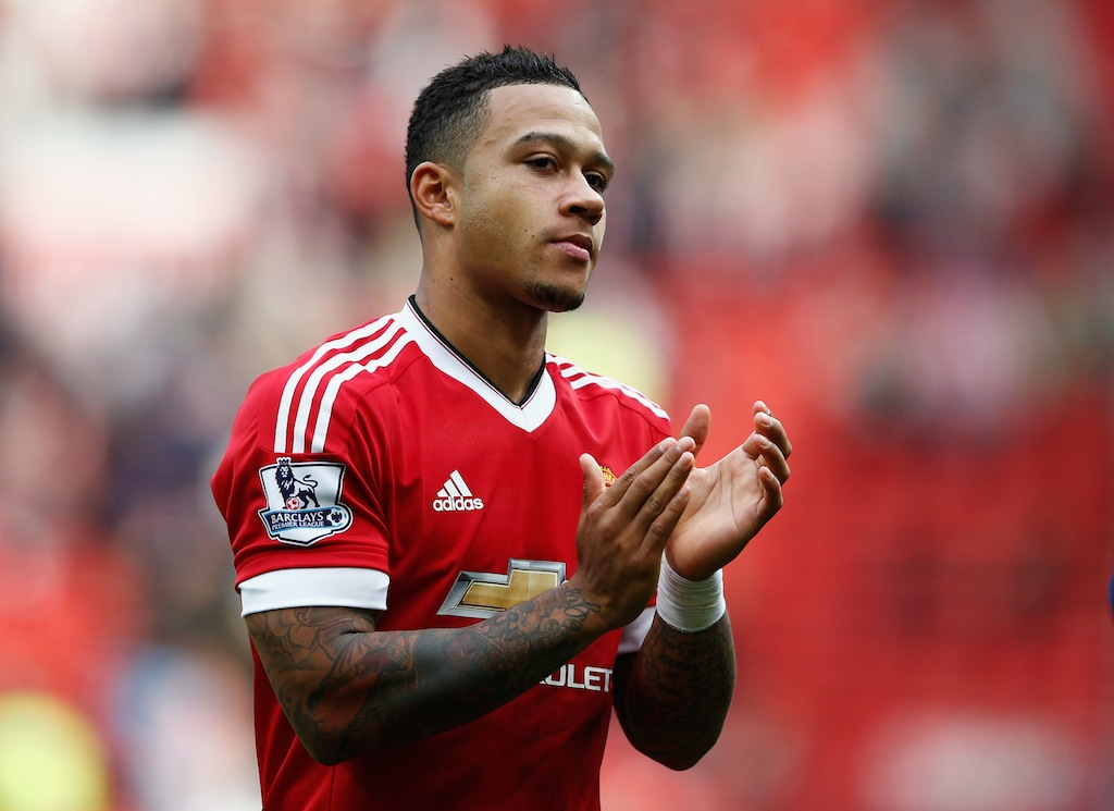 Memphis Depay applauds after a Manchester United victory