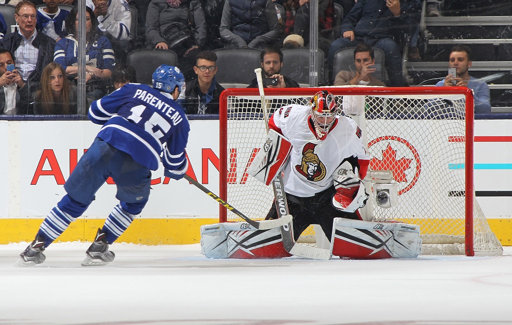 TORONTO, ON - OCTOBER 10: PA Parenteau #15 of the Toronto Maple Leafs beats Craig Anderson #41 of the Ottawa Senators in the shoot-out during an NHL game at the Air Canada Centre on October 10, 2015 in Toronto, Ontario, Canada. The Senators defeated the Leafs 5-4 in an overtime shoot-out.