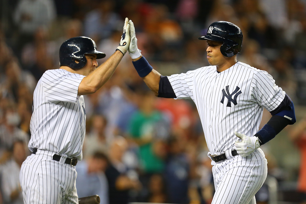 Mike Stobe/Getty Images Alex Rodriguez #13 is greeted by Mark Teixeira #25 after connecting on a solo home run