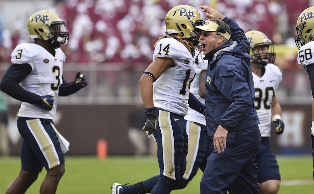 Pitt coach Pat Narduzzi celebrates with his team after an interception