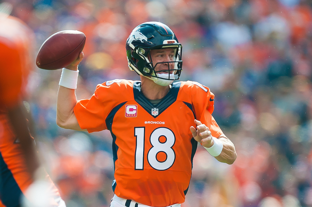 Peyton Manning throws against the Vikings
