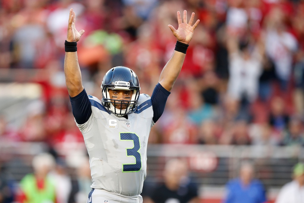 Russell Wilson celebrates a touchdown