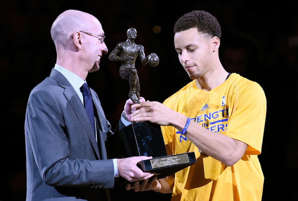 Adam Silver presents Stephen Curry with the 2014-15 MVP award