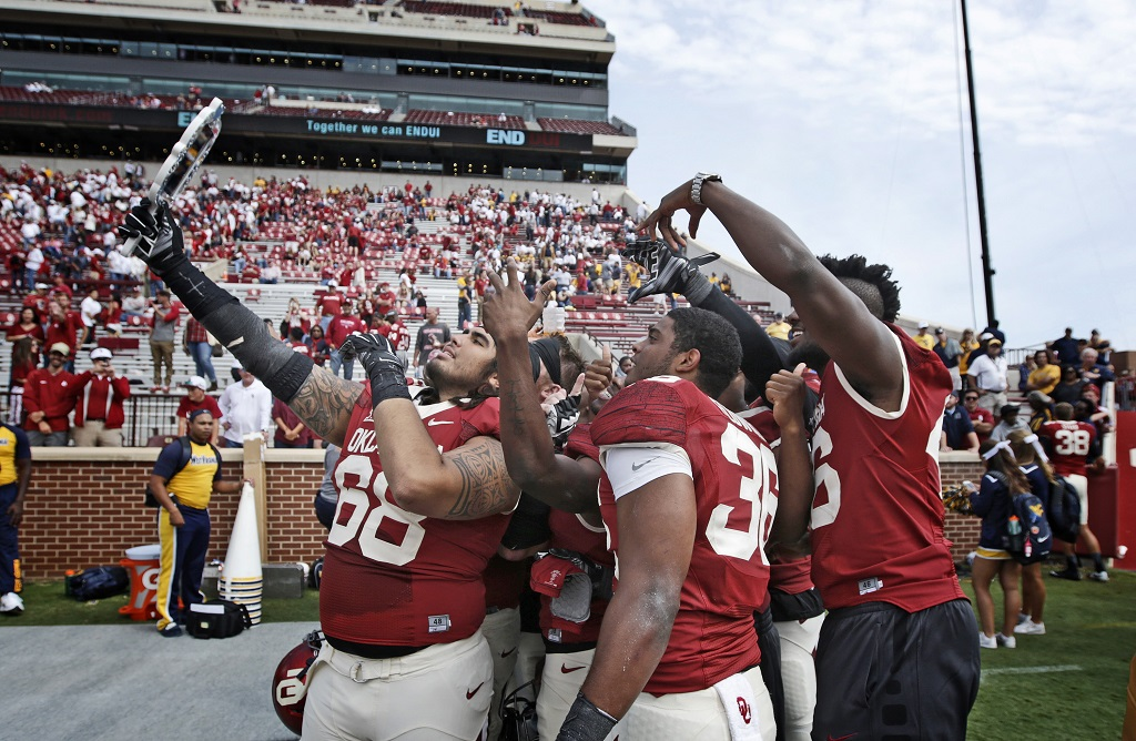 NORMAN, OK - OCTOBER 3:  Some Oklahoma Sooners take 'selfies' after the game against the West Virginia Mountaineers October 3, 2015 at Gaylord Family-Oklahoma Memorial Stadium in Norman, Oklahoma. Oklahoma defeated West Virginia 44-24